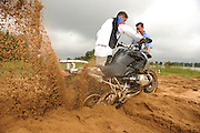 A BMW instructor and GS Challenge judge ? buries an R1200GS deep in the sand at the BMW Performance and Test Center in Spartanburg, SC during the GS Trophy competition.  Contestents had to race to see who could get their bike out of the deep sand the fastest.