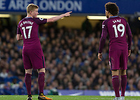 Football - 2017 / 2018 Premier League - Chelsea vs Manchester City<br /> <br /> Kevin De Bruyne (Manchester City) points the way to the Chelsea goal for Leroy Sane (Manchester City) at Stamford Bridge <br /> <br /> COLORSPORT/DANIEL BEARHAM