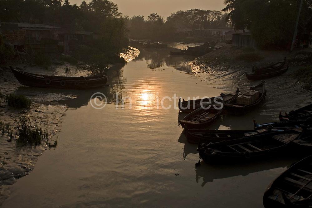 Boats (sampan) on an inlet of the Karnaphuli River, Chittagong, Bangladesh