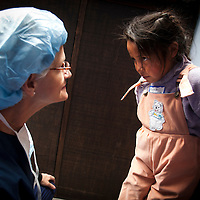 Nurse Lettie Turner comes to prep Elena, whose hands were not completely formed at birth.   Oregon orthopedic doctors and support staff helped hundreds of Peruvian children in Coya, Peru performing corrective surgeries and therapy to improve their quality of life.