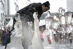 © under license to London News Pictures.  15/01/2011. A sculptor at work.  The 3rd London Ice Sculpting Festival was held in Canada Square Park, Canary Wharf today (Sat). The festival has timed competitions between ice sculpting teams from around the globe: Africa, France, Hungary, Netherlands, Portugal and the UK.Picture credit should read Ed Brown/London News Pictures