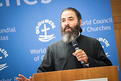 """18 September 2017, Geneva, Switzerland: The World Council of Churches formally opens the """"12 Faces of Hope"""" exhibition at the Ecumenical Centre in Geneva. The exhibition faces 12 people from Israel and Palestine, sharing testimonies of hope, towards a future of justice and peace in the Holy Land. Here, Jack Khalil from the Greek Orthodox Patriarchate of Antioch and all the East."""