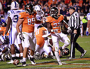 CHARLOTTESVILLE, VA- NOVEMBER 12:  Running back Perry Jones (33) and tight end Colter Phillips (89) of the Virginia Cavaliers celebrate a touchdown against the Duke Blue Devils during the game on November 12, 2011 at Scott Stadium in Charlottesville, Virginia. Virginia defeated Duke 31-21. (Photo by Andrew Shurtleff/Getty Images) *** Local Caption *** Colter Phillips;Perry Jones
