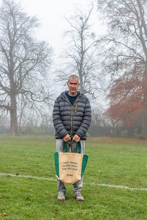 A portrait of a man in Pittville Park, Cheltenham during the second UK national lockdown November 2020. Credit: Joseph Walsh/UoG/PathosImages
