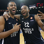 Anadolu Efes's Alfred Jamon Lucas (R) and Joshua Shipp (L) celebrate victory during their Turkish Airlines Euroleague Basketball Top 16 Game 7 match Anadolu Efes between Real Madrid at the Abdi ipekci Arena in Istanbul, Turkey, Thursday, February 14, 2013. Photo by TURKPIX