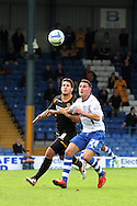 Newport County's Danny Crow and Bury's Jordan Mustoe (r) eye up the  ball. Skybet Football League two match, Bury v Newport county at Gigg Lane in Bury on Saturday 5th Oct 2013. pic by David Richards, Andrew Orchard sports photography,