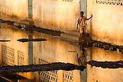 A boy walks along the main classroom block at the Avedji primary school in the village of Avedji, Benin on Monday October 25, 2010. Many schools remain closed in Benin following floods that have affected most of the country.