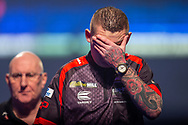 Nathan Aspinall (England) holds his head in his hands during the William Hill World Darts Championship at Alexandra Palace, London, United Kingdom on 28 December 2020.
