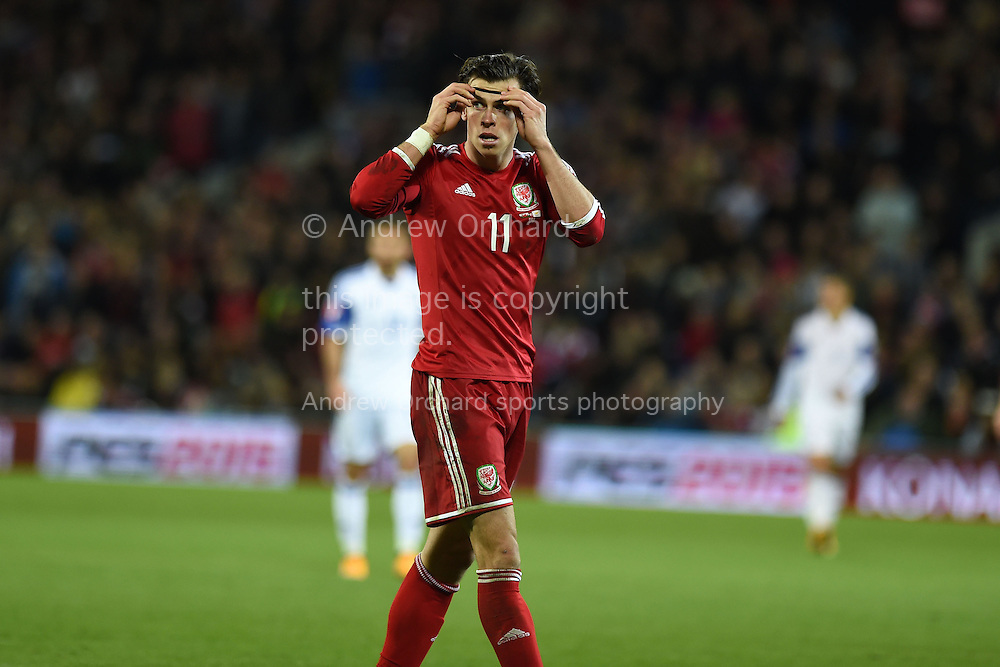 Gareth Bale of Wales looks on. Euro 2016 qualifying group B match, Wales v Cyprus at the Cardiff city Stadium in Cardiff, South Wales on Monday 13th Oct 2014.<br /> pic by Andrew Orchard, Andrew Orchard sports photography.