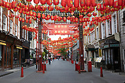 Gerrard Street in Chinatown is eerily quiet and silent on empty streets as lockdown continues and people observe the stay at home message in the capital on 12th May 2020 in London, England, United Kingdom. Coronavirus or Covid-19 is a new respiratory illness that has not previously been seen in humans. While much or Europe has been placed into lockdown, the UK government has now announced a slight relaxation of the stringent rules as part of their long term strategy, and in particular social distancing.