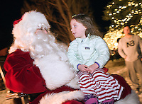 Bradley Bryant, 3, delivers her Christmas wish list to Santa Claus after the Town Square Lighting ceremony Friday evening in downtown Jackson.
