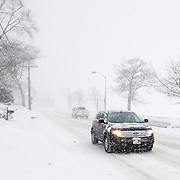 Morning traffic is light on Main Street in Wakefield, MA during a snowstorm that caused the closing of all the town's schools.