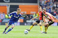 Cardiff City's Stuart O'Keefe (l) has the ball while being chased by Birmingham's Charlee Adams (r).  Skybet football league championship match, Cardiff city v Birmingham city at the Cardiff city stadium in Cardiff, South Wales on Saturday 7th May 2016.<br /> pic by Carl Robertson, Andrew Orchard sports photography.