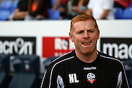 Bolton Wanderers Manager Neil Lennon looks on prior to kick off. Skybet football league championship match, Bolton Wanderers v Derby County at the Macron stadium in Bolton, Lancs on Saturday 8th August 2015.<br /> pic by Chris Stading, Andrew Orchard sports photography.
