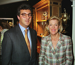 MR ADRIAN SASSOON and MRS KERRY PACKER, at an antiques fair in London on 9th June 1999.MSY 21