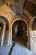 """Pictures & images of Kalburlu (St. Epthemios) church interior, 9th century, the Vadisi Monastery Valley, """"Manastır Vadisi"""",  of the Ihlara Valley, Guzelyurt , Aksaray Province, Turkey.<br /> <br /> Kalburlu (St. Epthemios) church dates back to the 9th or 10th century. It is carved out of a single rock massive with rock columns holding up the roof of its church . The arches of Kalburlu (St. Epthemios) church have rich architectural decorated relif sculptures. The naves are connected by rounded arches & there is a baptismal font to the east of the main entrance. .<br /> <br /> If you prefer to buy from our ALAMY PHOTO LIBRARY  Collection visit : https://www.alamy.com/portfolio/paul-williams-funkystock/vadisi-monastery-valley-turkey.html<br /> <br /> Visit our TURKEY PHOTO COLLECTIONS for more photos to download or buy as wall art prints https://funkystock.photoshelter.com/gallery-collection/3f-Pictures-of-Turkey-Turkey-Photos-Images-Fotos/C0000U.hJWkZxAbg"""