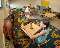 """Children gather in the rooms of the Boys and Girls Club of the Lakes Region as they begin their first week in their new """"home"""" on North Main Street in Laconia.  (Karen Bobotas/for the Laconia Daily Sun)"""