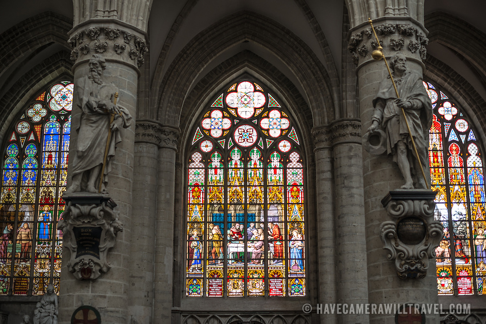 Three of the stained glass windows at the Cathedral of St. Michael and St. Gudula (in French, Co-Cathédrale collégiale des Ss-Michel et Gudule). A church was founded on this site in the 11th century but the current building dates to the 13th to 15th centuries. The Roman Catholic cathedral is the venue for many state functions such as coronations, royal weddings, and state funerals. It has two patron saints, St Michael and St Gudula, both of whom are also the patron saints of Brussels.