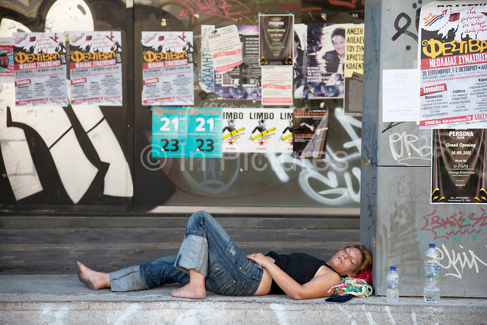 Street scene in Monastiraki. A woman sleeping in the evening heat. Athens is the capital and largest city of Greece. It dominates the Attica periphery and is one of the world's oldest cities, as its recorded history spans around 3,400 years. Classical Athens was a powerful city-state. A centre for the arts, learning and philosophy.