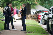 Police speak with a neighbor outside an apartment where a second Ebola patient has been reported in Dallas, Texas on October 12, 2014. (Cooper Neill for The New York Times)