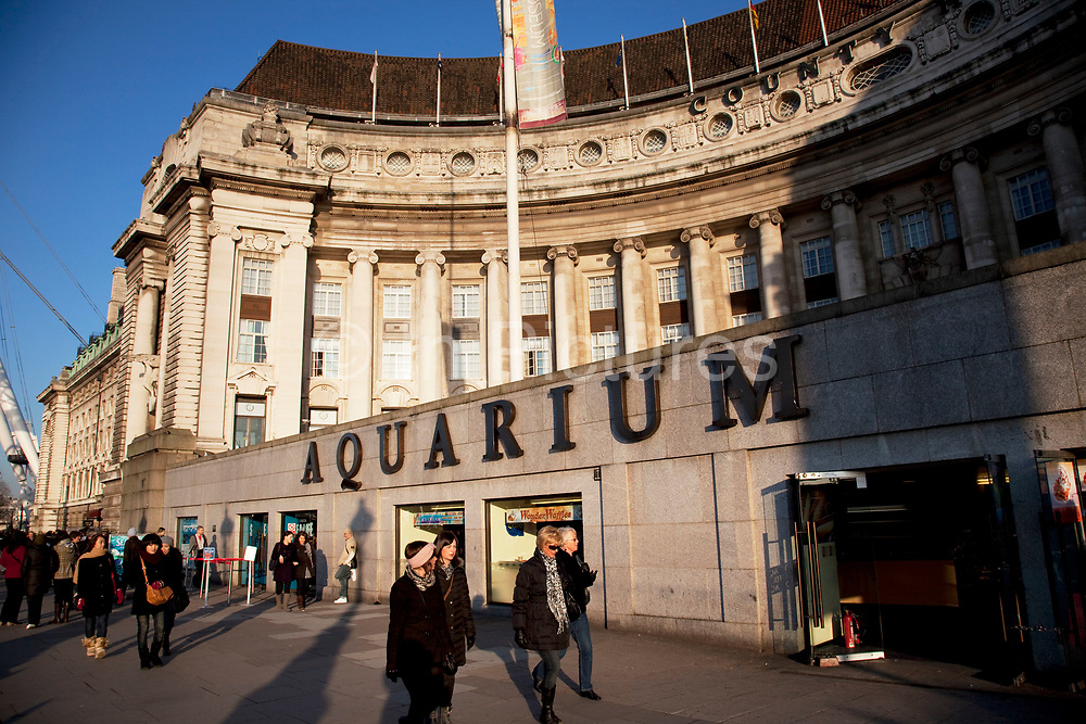 Exterior of The London Aquarium which is in the old GLC building in central London. A great draw for tourism. The Sea Life London Aquarium is located on the ground floor of County Hall on the South Bank. It first opened in March 1997 and remains the capital's largest collection of aquatic species. The attraction claims that a million visitors a year view its displays
