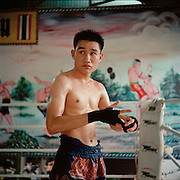 Chiang Mai, Thailand. Fighters, trainers and family that make up Chay Yai Muay Thai gym in Chiang Mai, Thailand. Photos by Tiffany L. Clark