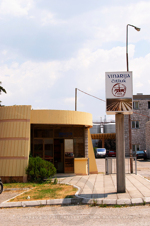 The entrance to the winery, the gate, the main winery building and a sign saying 'Vinarija Citluk 1353'. Vinarija Citluk winery in Citluk near Mostar, part of Hercegovina Vino, Mostar. Federation Bosne i Hercegovine. Bosnia Herzegovina, Europe.