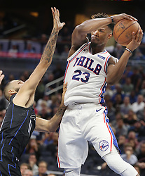 November 14, 2018 - Orlando, FL, USA - The Philadelphia 76ers' Jimmy Butler (23) pulls down a rebound over the Orlando Magic's Evan Fournier at the Amway Center in Orlando, Fla., on Wednesday, Nov. 14, 2018. The Magic won, 111-106. (Credit Image: © Stephen M. Dowell/Orlando Sentinel/TNS via ZUMA Wire)