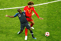 SAINT PETERSBURG, RUSSIA - JULY 10: Ngolo Kante (L) of France national team and Marouane Fellaini of Belgium national team vie for the ball during the 2018 FIFA World Cup Russia Semi Final match between France and Belgium at Saint Petersburg Stadium on July 10, 2018 in Saint Petersburg, Russia. MB Media
