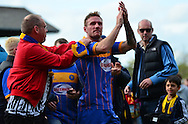 Shrewsbury Captain Liam Lawrence celebrates with the fans during the Sky Bet League 2 match between Cheltenham Town and Shrewsbury Town at Whaddon Road, Cheltenham, England on 25 April 2015. Photo by Alan Franklin.