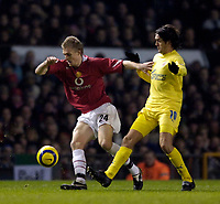 Photo: Jed Wee.<br /> Manchester United v Villarreal. UEFA Champions League.<br /> 22/11/2005.<br /> <br /> Manchester United's Darren Fletcher (L) tries to turn away from Villarreal's Roger.