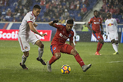 March 1, 2018 - Harrison, New Jersey, United States - Club Deportivo Olimpia Defender LUIS OVALLE (4) protects the ball from New York Red Bulls midfielder SEAN DAVIS (27) during the CONCACAF Champions league match at Red Bull Arena in Harrison, NJ.  NY Red Bulls defeat CD Olimpia 2-0  (Credit Image: © Mark Smith via ZUMA Wire)