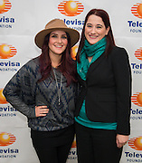 """Telenovela actress Dulce Maria, left, Rosa Hernandez, right, pose for a photograph following a Televisa Foundation """"Live the Dream"""" event at Burbank Middle School, December 9, 2013."""