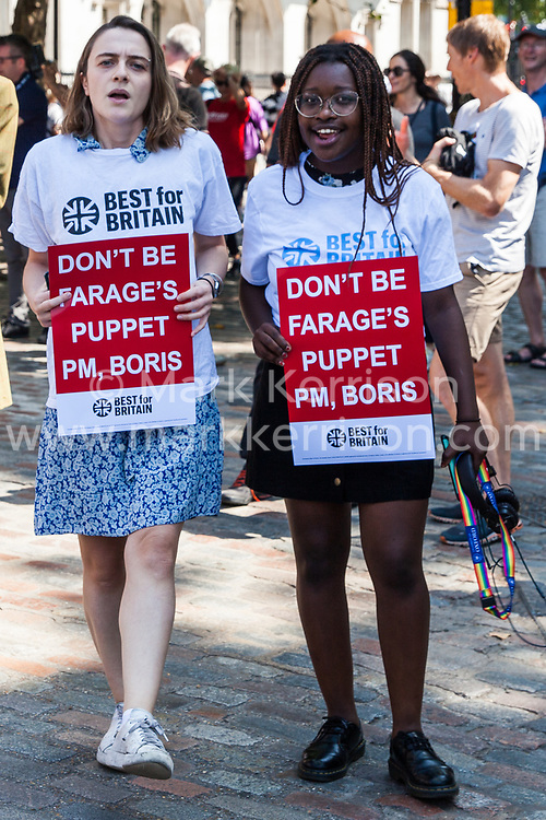 London, UK. 23 July, 2019. Campaigners from Best for Britain protest outside the Queen Elizabeth II Centre prior to the announcement inside the venue that Boris Johnson had been elected as leader of the Conservative Party and would replace Theresa May as Prime Minister.