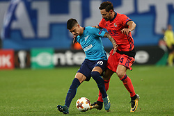September 28, 2017 - Saint Petersburg, Russia - Emiliano Rigoni of FC Zenit Saint Petersburg (L) and Alberto de la Bella of FC Real Sociedad vie for the ball during the UEFA Europa League Group L football match between FC Zenit Saint Petersburg and FC Real Sociedad at Saint Petersburg Stadium on September 28, 2017 in St.Petersburg, Russia. (Credit Image: © Igor Russak/NurPhoto via ZUMA Press)