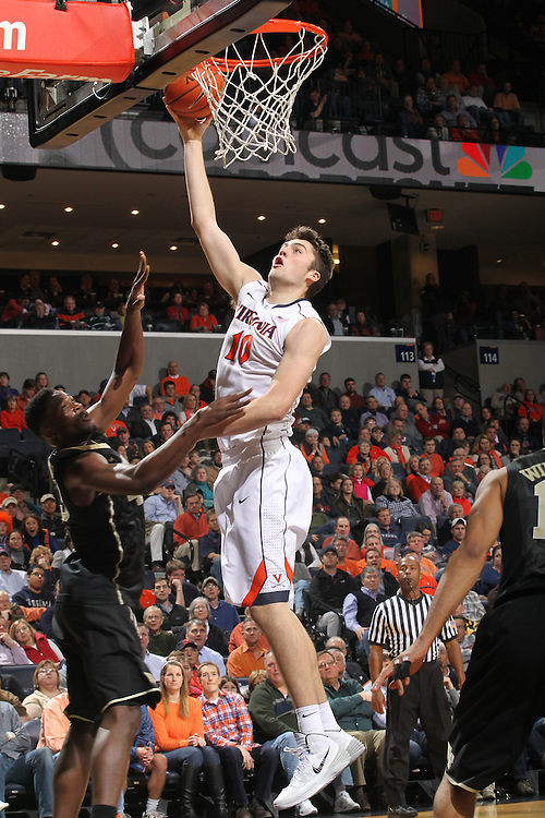 Virginia forward/center Mike Tobey (10) shoots over Wake Forest forward Arnaud William Adala Moto (45) during the game Wednesday Jan. 08, 2014 in Charlottesville, Va. Virginia defeated Wake Forest 74-51.