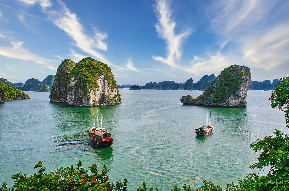 Luxury junk boats anchored in the popular tourist destination of Ha Long Bay in Northern Vietnam - A UNESCO World Heritage Site.<br /> <br /> Photo: Steve Kingsman