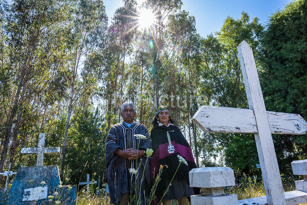 Don Rosendo Curilaf, 90 and wife Margarita 89 at the burial site of their ancestors, a Mapuche cementary in Cuno. Rosendo is a guardian of tradition and culture and knows everything about Mapuche rites and rituals, including burial which he conducts at the request of members of his community. Cuno, Chile. February 12, 2018.