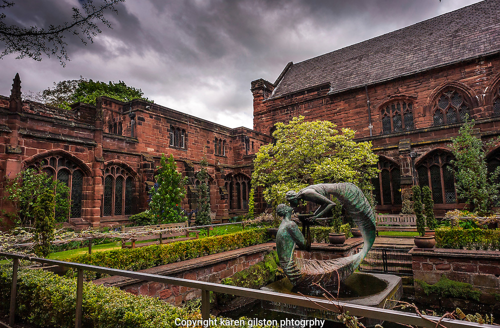 inner courtyard Chester Cathedral showing bronze statue and architectural details