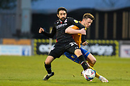 Scunthorpe United Jem Karacan (23) Mansfield Town Ollie Clarke (8) battles for possession during the EFL Sky Bet League 2 match between Mansfield Town and Scunthorpe United at the One Call Stadium, Mansfield, England on 20 April 2021.