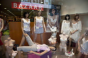Shop window with mannequins selling women's clothing in the area of Monastiraki. There is an abundance of cheap inexpensive clothing available. Athens is the capital and largest city of Greece. It dominates the Attica periphery and is one of the world's oldest cities, as its recorded history spans around 3,400 years. Classical Athens was a powerful city-state. A centre for the arts, learning and philosophy.