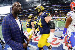 Thad Bullard shakes hands with members of the Michigan Wolverines during the Chick-fil-A Peach Bowl, Saturday, December 29, 2018, in Atlanta. ( Paul Abell via Abell Images for Chick-fil-A Peach Bowl)