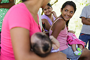 A girl holds her younger sibling as they wait during a vaccination session at the primary school in the town of Coyolito, Honduras on Wednesday April 24, 2013.