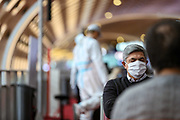 "An Asian air passenger is seen wearing a white hazmat suit, as well as surgical face protective masks to curb the spread of Coronavirus pandemic outbreak, wait for his flight in Terminal E2 at the Charles de Gaulle Airport in Paris, on Saturday, Dec 12, 2020. France recorded about 2,351,372 coronavirus infections, with 57,567<br /> of them resulting in death and 175,891 of them recovered. Internal European borders will remain open but external borders are closed except for essential travel. All travellers arriving in France will be tested at airports and ports says the government website adding that the ""Masks must be worn at all times in public transport"". (VXP Photo/ Vudi Xhymshiti)"