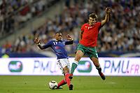 FOOTBALL - UEFA EURO 2012 - QUALIFYING - GROUP D - FRANCE v BELARUS - 3/09/2010 - PHOTO JEAN MARIE HERVIO / DPPI - YANN M'VILA (FRA) / VITALI KUTUZAU (BIE)