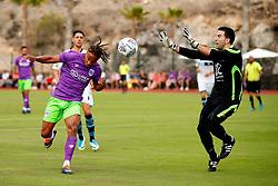 Bobby Reid of Bristol City challenges the Guimar goalkeeper - Mandatory by-line: Matt McNulty/JMP - 22/07/2017 - FOOTBALL - Tenerife Top Training - Costa Adeje, Tenerife - Bristol City v Atletico Union Guimar  - Pre-Season Friendly