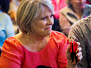 26 APRIL 2019 - TIPTON, IOWA: A woman holds a small Elizabeth Warren action figure during a campaign appearance by Sen. Elizabeth Warren in Tipton, IA. Sen. Warren is campaigning in eastern Iowa Friday. Iowa traditionally hosts the the first selection event of the presidential election cycle. The Iowa Caucuses will be on Feb. 3, 2020.                 PHOTO BY JACK KURTZ
