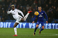 Sheyo Ojo of Fulham gets the ball ahead of Joe Bennett of Cardiff city (r).   EFL Skybet championship match, Cardiff city v Fulham at the Cardiff city stadium in Cardiff, South Wales on Boxing Day, Tuesday 26th December 2017.<br /> pic by Andrew Orchard, Andrew Orchard sports photography.