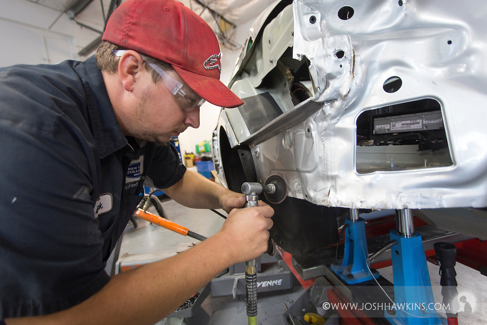 Brock Burton working on a car on a special Audi lift. <br /> <br /> JH_201510021058_MG_5917.CR2<br /> 10/2/2015  --  10:58:31