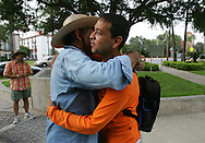 Jay Johnson Castro embraces Pedro Salazar, a self-proclaimed illegal immigrant from Matamoros, who crossed the river desperately looking for work.  Salazar joined the walk through McAllen before disappearing into the city in search of a place to stay.